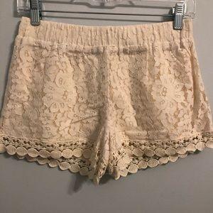 Cream-colored crochet shorts
